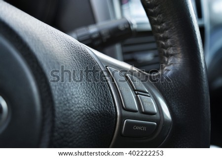 Cars wheel with switch of cruise control, close, selective focus - stock photo
