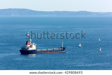 Carso Ship Surrounded by Sailboats in the Gulf of Trieste, Italy - stock photo