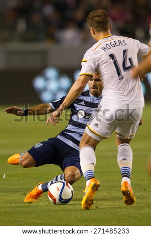 CARSON, CA. - APR 18: Benny Feilharber & Robbie Rogers in action during the L.A. Galaxy game against Sporting Kansas City on April 18, 2015 at the StubHub Center in Carson, California. - stock photo