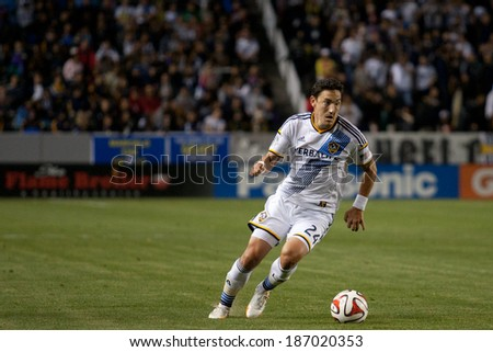 CARSON, CA - APRIL 12: Los Angeles Galaxy M Stefan Ishizaki #24 during the MLS game between the Los Angeles Galaxy & the Vancouver Whitecaps on April 12th 2014 at the StubHub Center. - stock photo