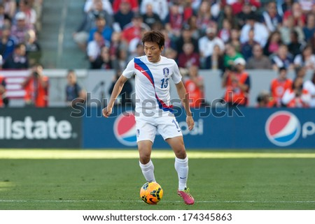 CARSON, CA. - FEB 01: Korea M Myung-Joo Lee #13 in action during the U.S. mens national team soccer friendly against Korea Republic on Feb 1st 2014 at the StubHub Center in Carson, Ca. - stock photo
