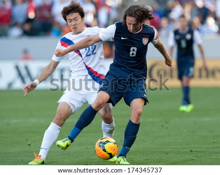 CARSON, CA. - FEB 01: USA M Mix Diskerud #8 & Korea M Jong-Woo Park #22 during the U.S. mens national team soccer friendly against Korea Republic on Feb 1st 2014 at the StubHub Center in Carson, Ca. - stock photo