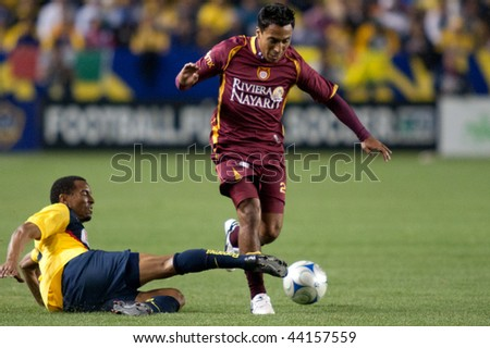 CARSON, CA. - JANUARY 9: Elgabry Rangel (R) tackled by Adolfo Rosinei (L) during the InterLiga 2010 match of Club America & Estudiantes Tecos at the Home Depot Center January 9, 2010 in Carson, CA. - stock photo