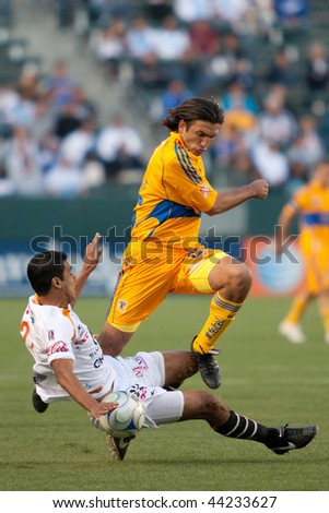 CARSON, CA. - JANUARY 10: Hugo Sanchez (L) and Francisco Fonseca (R) in action during InterLiga 2010 match of Tigres vs. Jaugares at the Home Depot Center on January 10, 2010 in Carson. - stock photo