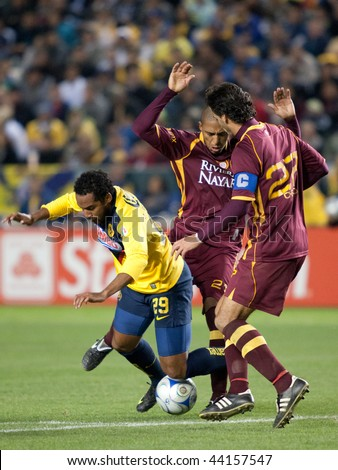 CARSON, CA. - JANUARY 9: Jean Beausejour (L) foulded by Diego Jimenez (C) & Juan Carlso (R) during the match of Club America & Estudiantes Tecos at the Home Depot Center January 9, 2010 in Carson, CA. - stock photo