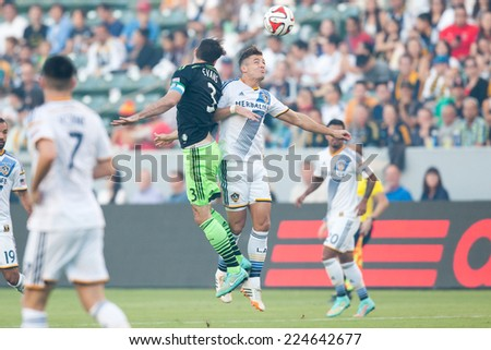 CARSON, CA - OCT 19: Brad Evans & Robbie Rogers fight for the ball during the Los Angeles Galaxy MLS game against the Seattle Sounders on October 19th 2014 at the StubHub Center. - stock photo