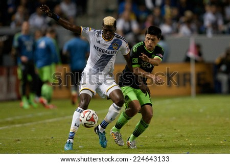 CARSON, CA - OCT 19: Gyasi Zardes & Gonzalo Pineda (R) during the Los Angeles Galaxy MLS game against the Seattle Sounders on October 19th 2014 at the StubHub Center. - stock photo