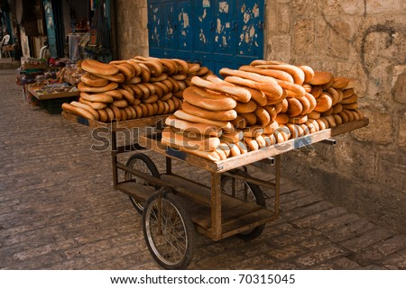 Cart of bread in the streets of Old Jerusalem. - stock photo