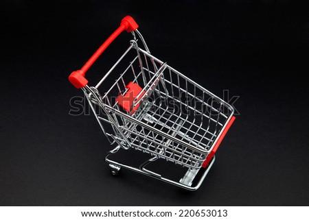 cart's supermarket on black background - stock photo