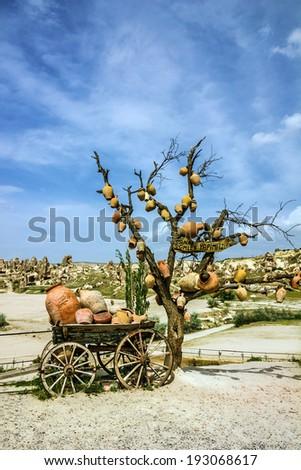 Cart with ceramic jugs in Cappadocia, Turkey - stock photo