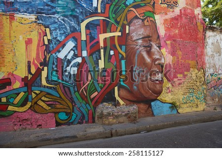 CARTAGENA, COLOMBIA - JANUARY 26, 2015: Colourful mural decorating a wall in the Getsemini area of the historic city of Cartagena in Colombia - stock photo