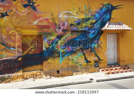 CARTAGENA, COLOMBIA - JANUARY 26, 2015: Colourful mural decorating the wall of a house in the Getsemini area of the historic city of Cartagena in Colombia - stock photo