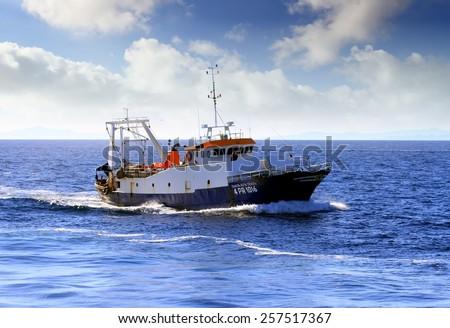 """CARTAGENA, SPAIN -?? JANUARY  25: The Italian trawler fishing boat """"SANTA RITA TERZA"""" is sailing close to the coast of Cartagena, on january 25, 2015 in Murcia. - stock photo"""