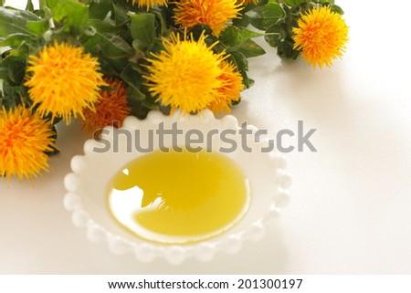 Carthamus tinctorius, Saffron flower on white background - stock photo