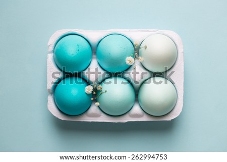 Carton of ombre dyed Easter eggs - stock photo