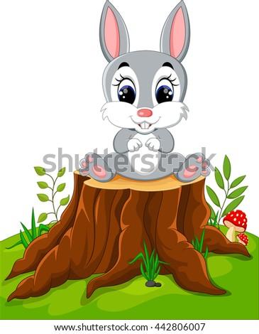 Cartoon Easter Bunny on tree stump - stock photo