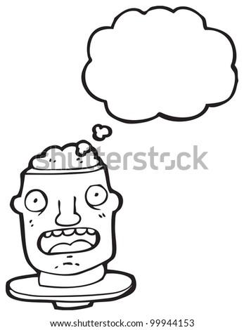 cartoon head on plate with exposed brain - stock photo