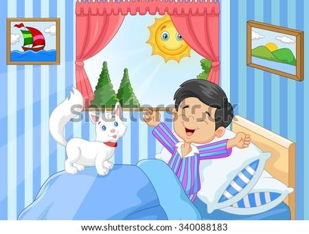 Cartoon Little boy woke up and yawns with cat animal  - stock photo