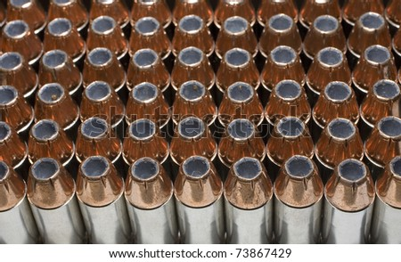 Cartridges and bullets that are used in a pistol or handgun - stock photo