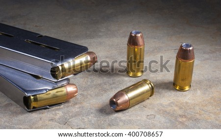 Cartridges for a semi automatic handgun loaded with hollow point bullets - stock photo