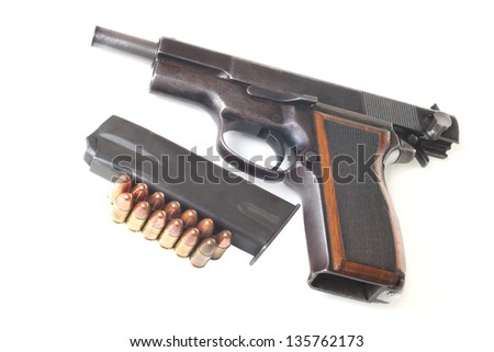 Cartridges, holder and discharged gun isolated on white background - stock photo