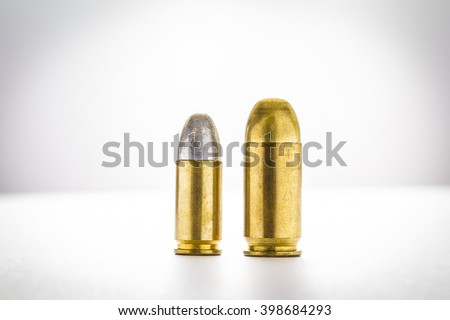 cartridges of 11mm and 9mm pistols ammo, Size does matter concept - stock photo