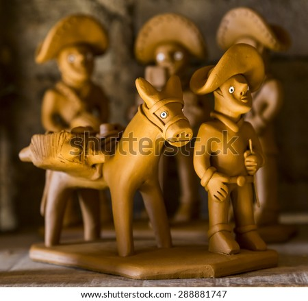 CARUARU, BRAZIL - MAY 6: Clay sculptures representing typical Brazilian Northeast people doing their daily tasks used as decoration and photographed in Caruaru, Pernambuco, Brazil on May 6, 2015. - stock photo