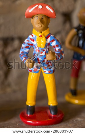 CARUARU, BRAZIL - MAY 6: Little clay sculpture with vibrant colors representing a Brazilian Northeast Forro Player commonly used as decoration in Pernambuco photographed on May 6, 2015 in Caruaru. - stock photo
