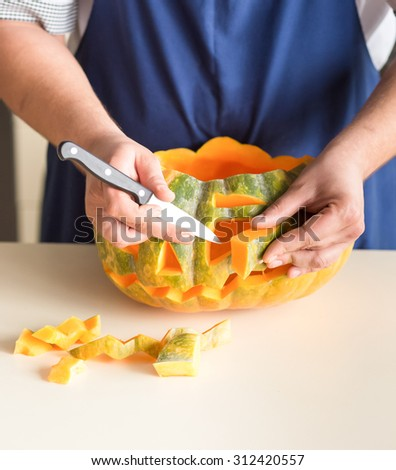 Carve out a pumpkin for halloween lantern - stock photo