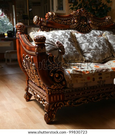 Carved antique luxury expensive sofa with cushions. Close up - stock photo