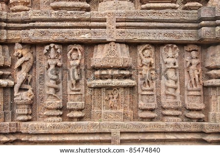 carved beautiful sculptures at Sun Temple, Konark - stock photo
