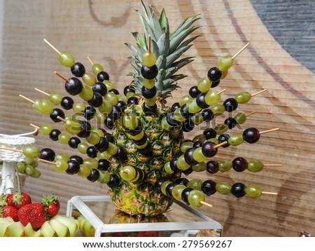 Carved fruits arrangement. Fresh various fruits. Assortment of exotic fruits. Fresh fruits decoration - stock photo