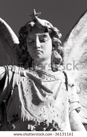 Carved marble gravestone in a cemetery, depicting an Angel - stock photo