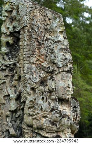 Carved pillar in Copan - ancient city of Maya. UNESCO World Heritage site. Honduras - stock photo