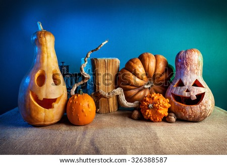 Carved pumpkins decoration at Halloween party on blue background - stock photo