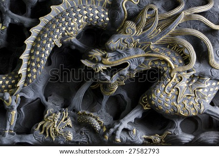 carved sculpture of chinese dragon - stock photo