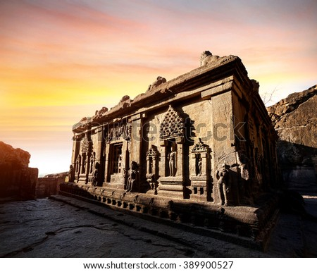 Carved statues in ruined building at sunset in Ellora cave near Aurangabad, Maharashtra, India - stock photo