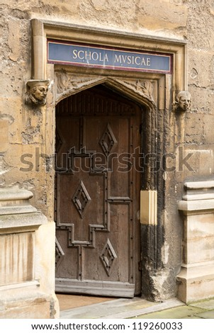 Carved wooden door at entrance to School of Music at Bodeian Library University of Oxford - stock photo