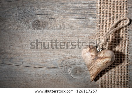 carved wooden heart on a grey background - stock photo