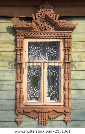 carved wooden window frame - stock photo