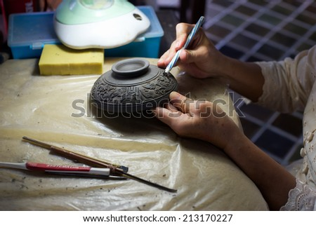 Carving clay for make ceramic - stock photo
