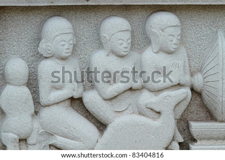 Carving on temple wall - stock photo