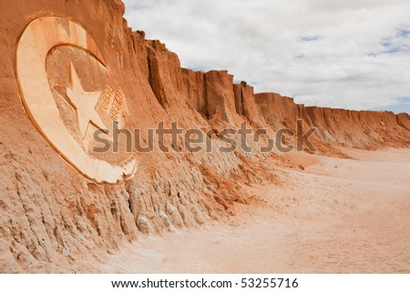 carving sign in Red beach of Canoa quebrada in ceara state brazil - stock photo
