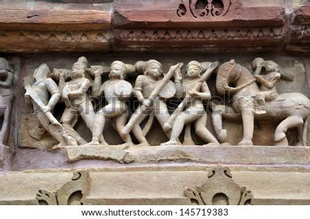 Carvings on temple walls at Khajuraho - stock photo