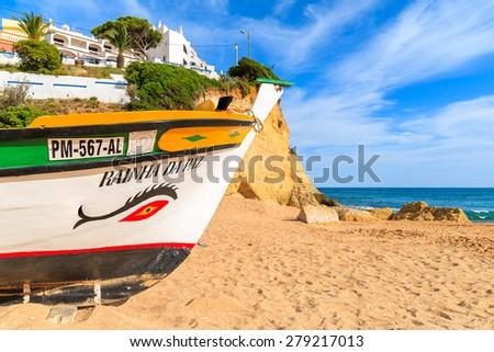 CARVOEIRO BEACH, PORTUGAL - MAY 17, 2015: bow of typical fishing boat on beach in Carvoeiro coastal village. Carvoeiro is popular holiday tourist destination on Algarve coast. - stock photo