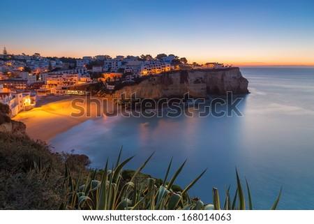 Carvoeiro village while climbing of the sun, sunrise. Portugal. - stock photo