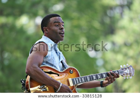 CARY, NORTH CAROLINA-AUGUST 27: Norman Brown performs on stage at Carolina Music Festival on August 27, 2006 in Cary, North Carolina. - stock photo