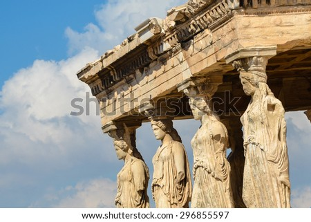 Caryatids portico on Acropolis, antique temple and marble culumns on the Acropolis site in Athens, Greece, with sea view. - stock photo