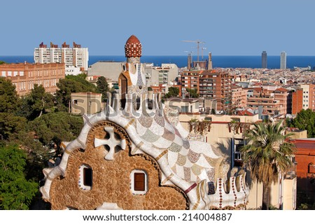 Casa del Guarda rooftop by Antoni Gaudi in Park Guell, and view over the city of Barcelona in Catalonia, Spain. - stock photo