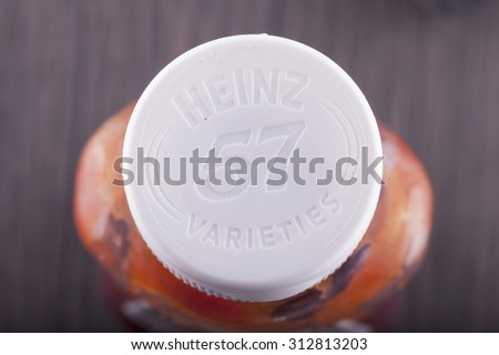 "CASALE MONFERRATO, ITALY - SEPTEMBER2, 2015: Heinz sauce cap, with famous slogan ""57 varieties"". Heinz, now part of Kraft Heinz Company is one of most historical brands in food industry - stock photo"